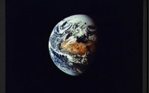 Earth as seen the window of the Apollo Crew Module